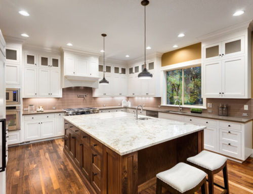 How Do Professionals Refinish Kitchen Cabinets?